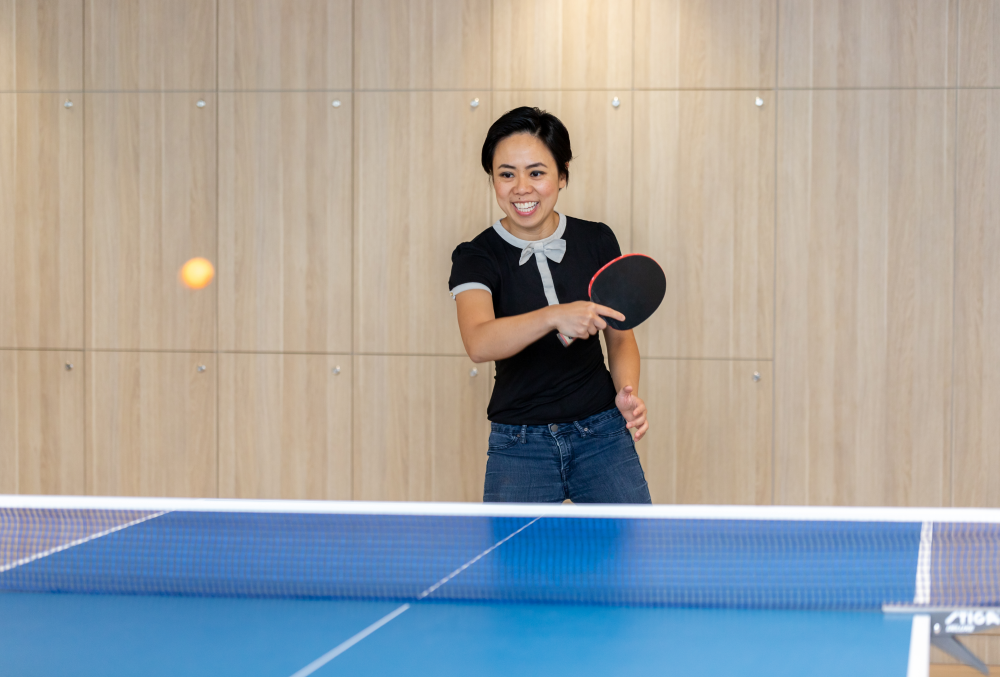 Exponential Trading Graduate- Young lady playing table tennis.