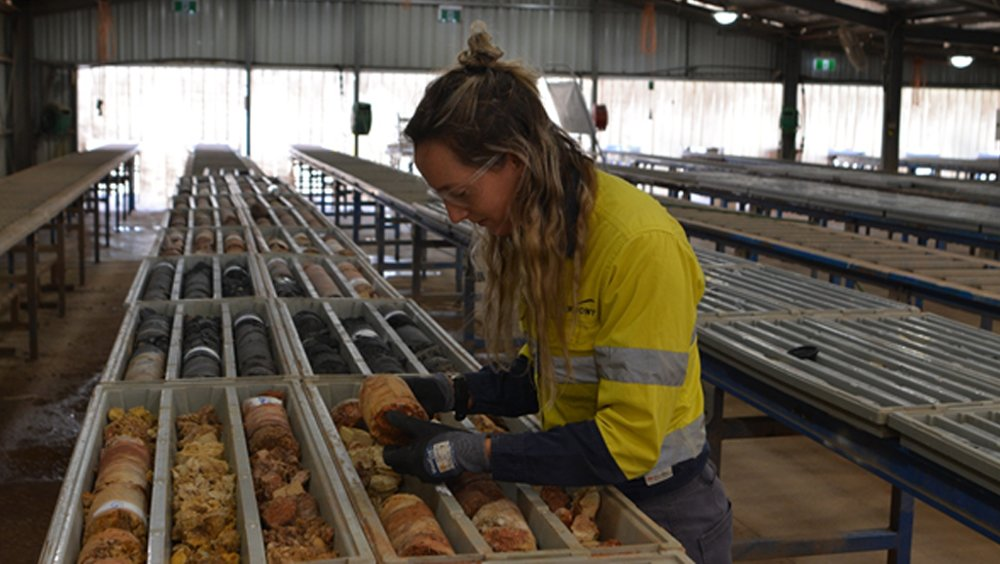 Newmont Graduate Courtney Anders with trays of drill core