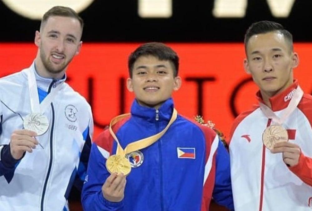 athletes holding their medal